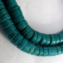 Coco wood turquoise disc beads. Per strand