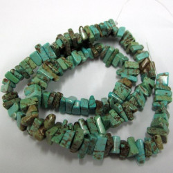 Magnesite chip beads. 15 inch strand